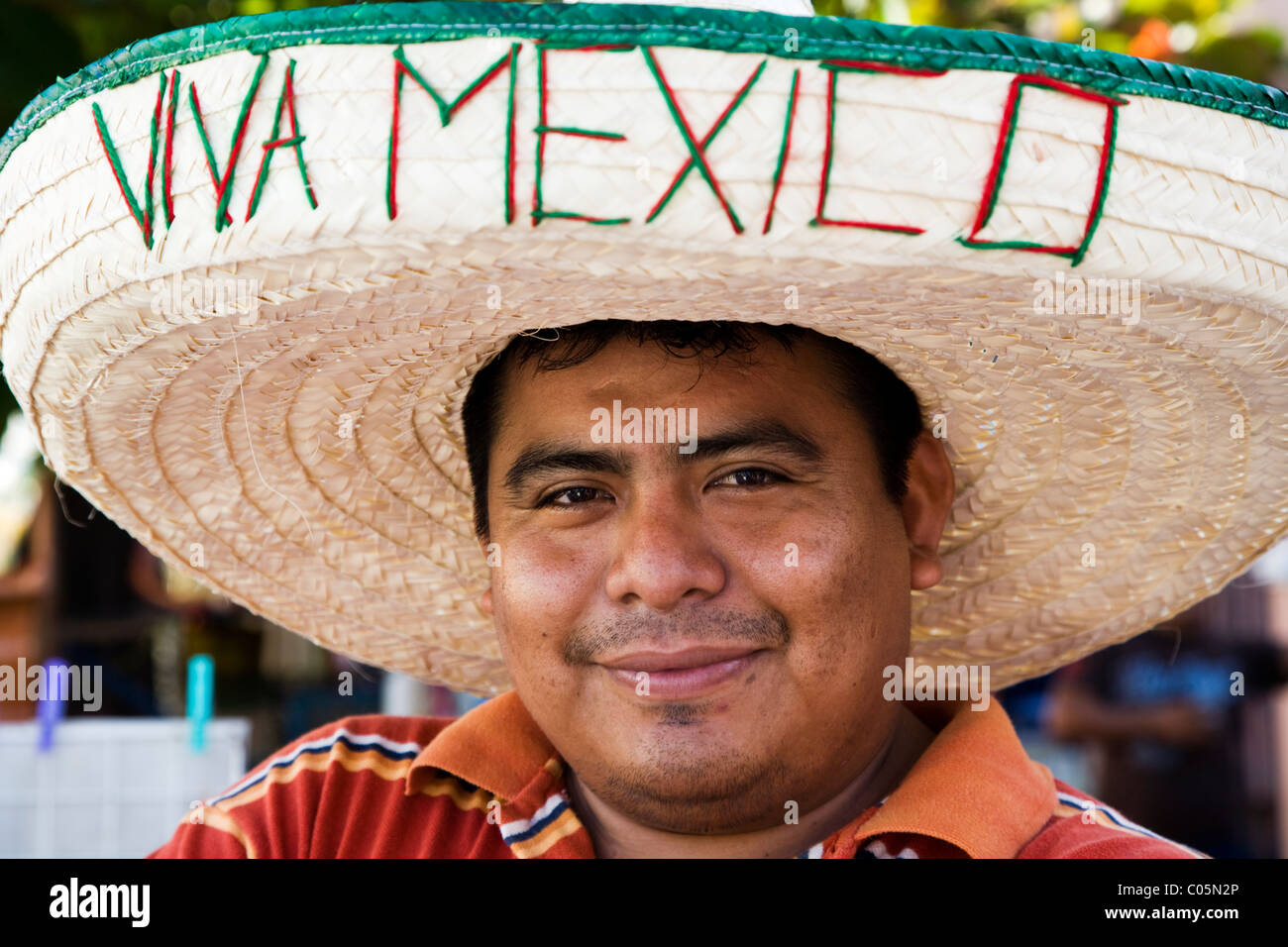 ccc9bc200cb Portrait of Mexican man from Yucatan wearing a sombrero with Viva Mexico on  it