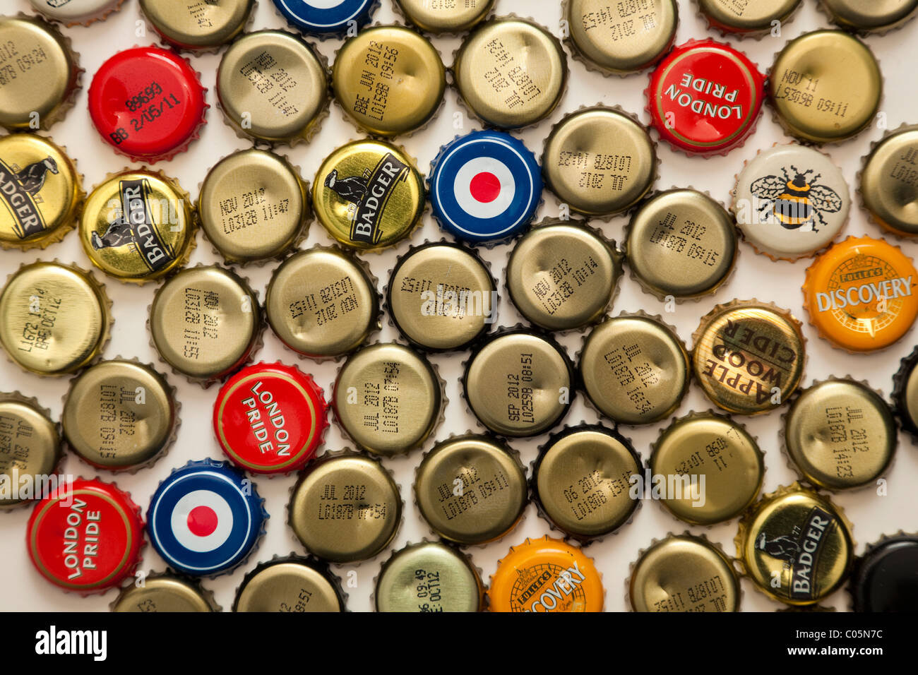 Crown beer bottle caps, some printed with brand names others