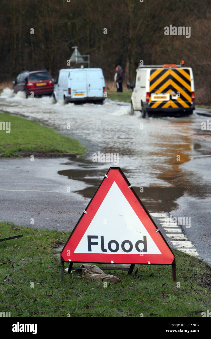A flood warning sign on a road in Essex - Stock Image