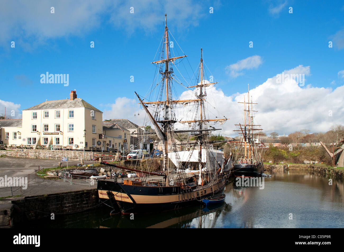 Tall ships in the harbour at Charlestown, Cornwall, UK - Stock Image