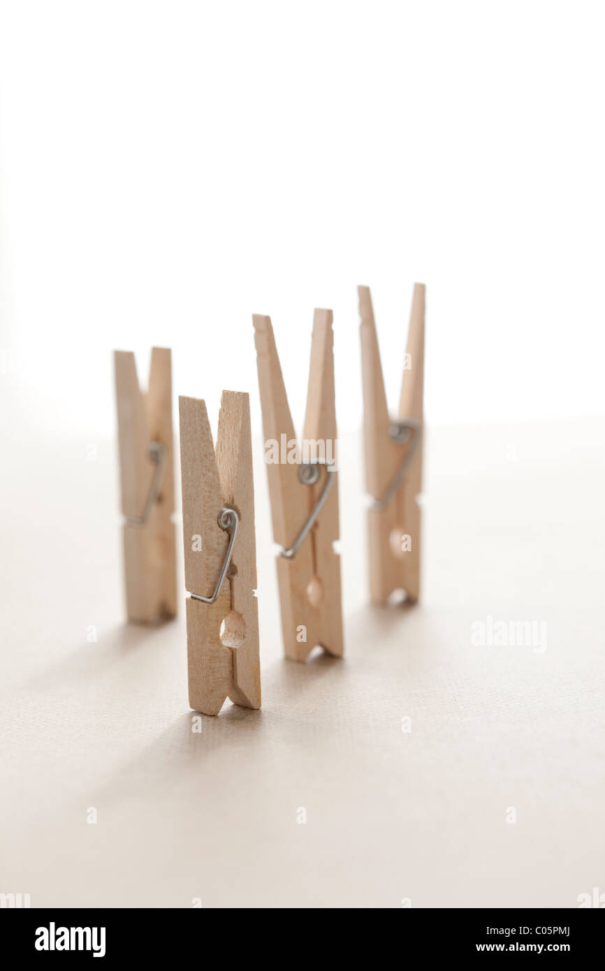 four clothes pins on heads - Stock Image