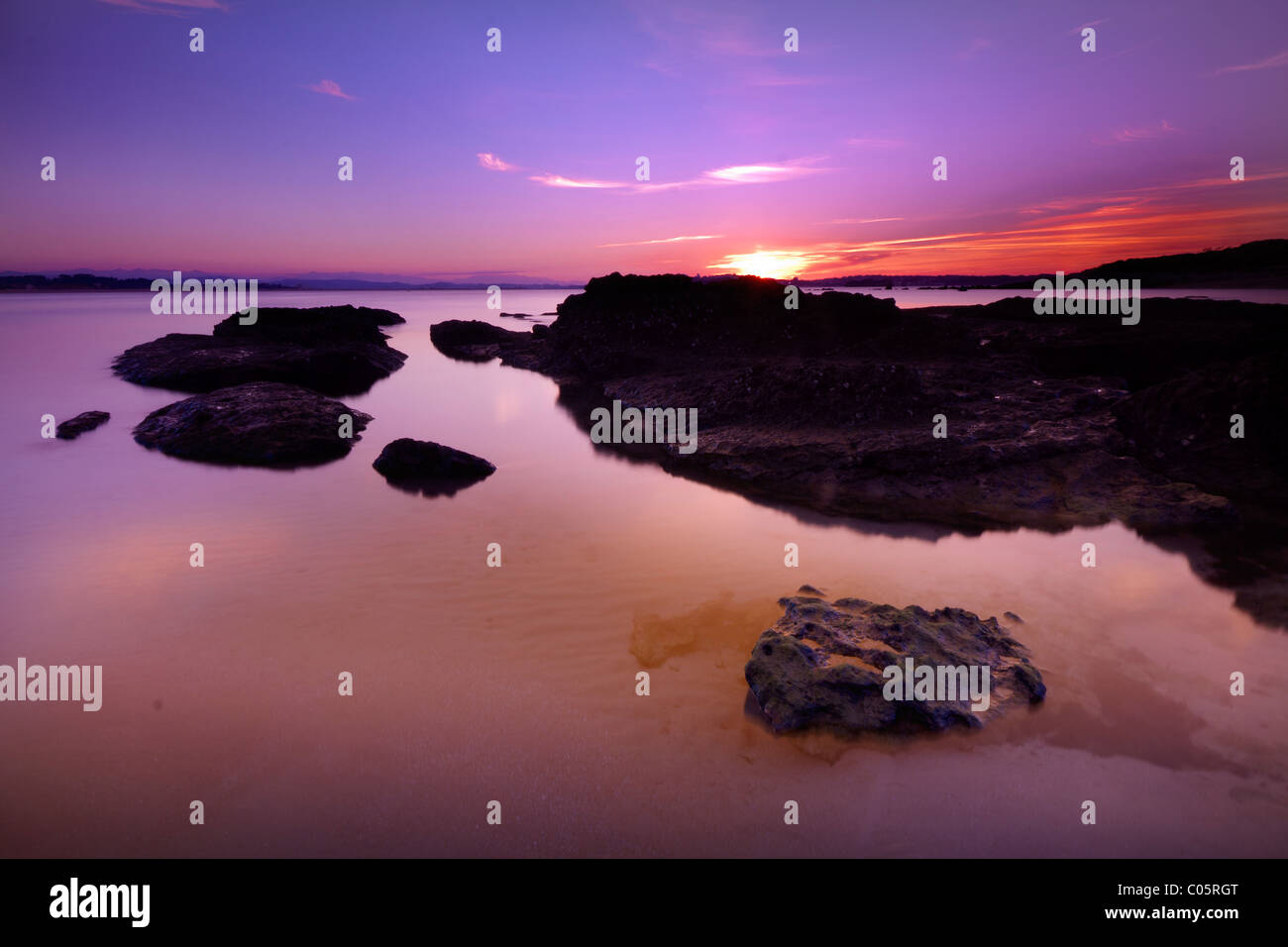 Twiligth. Cantabrian sea. Tidal ponds Stock Photo