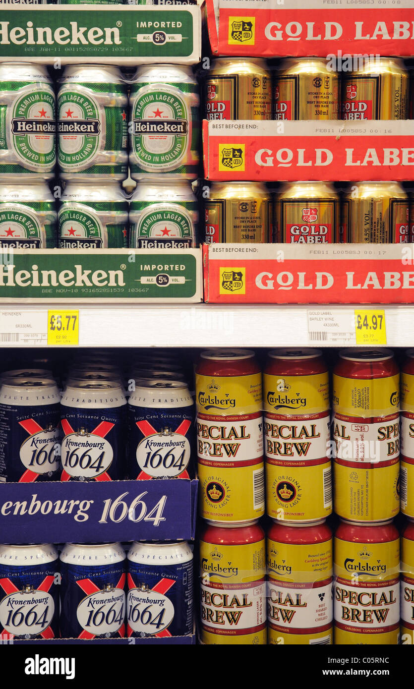 Tins of beer on a shelf in a supermarket in England - Stock Image