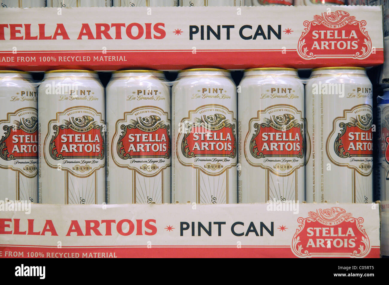 Cans of Stella on a shelf in a supermarket in England - Stock Image