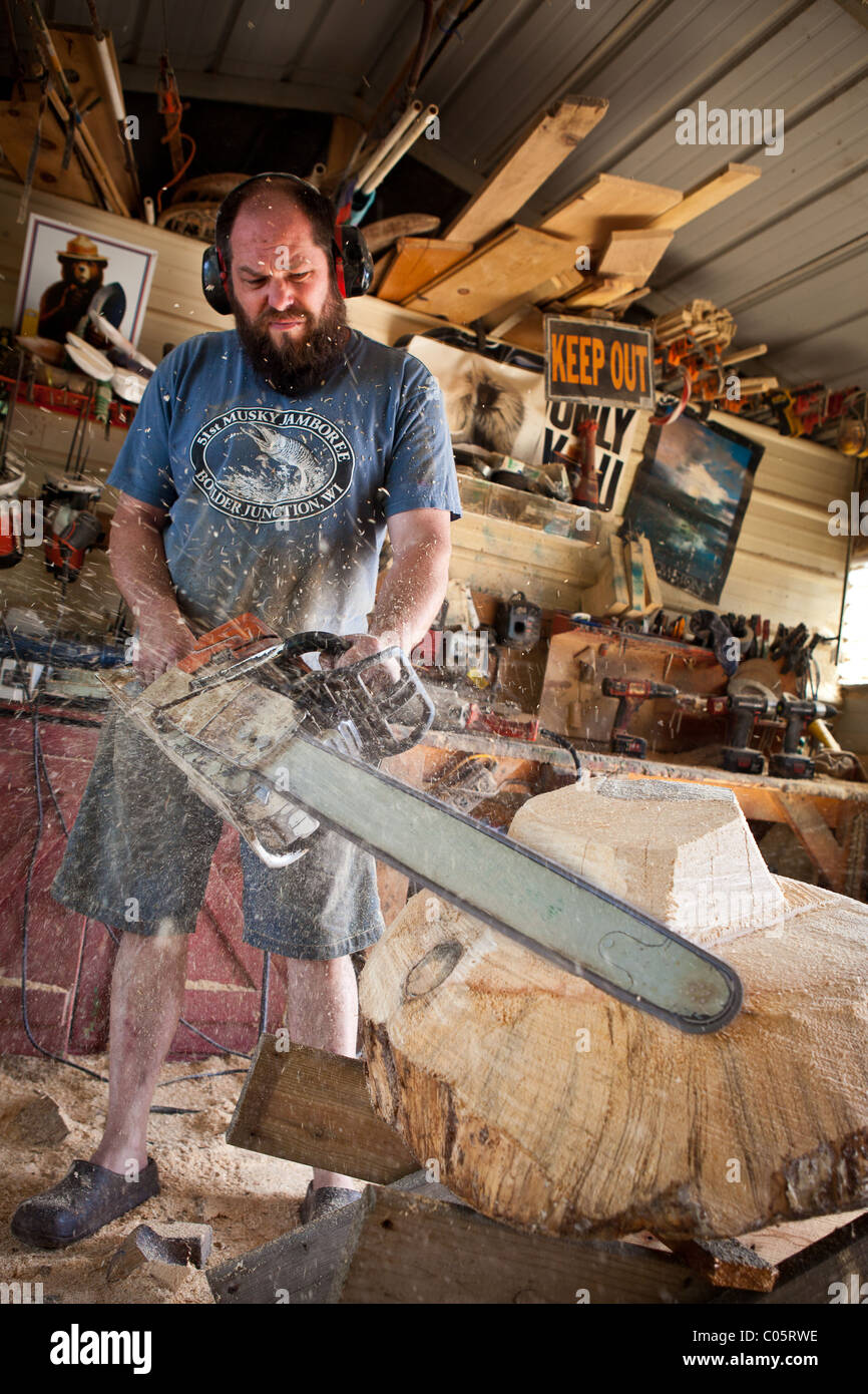 Chainsaw artist stock photos