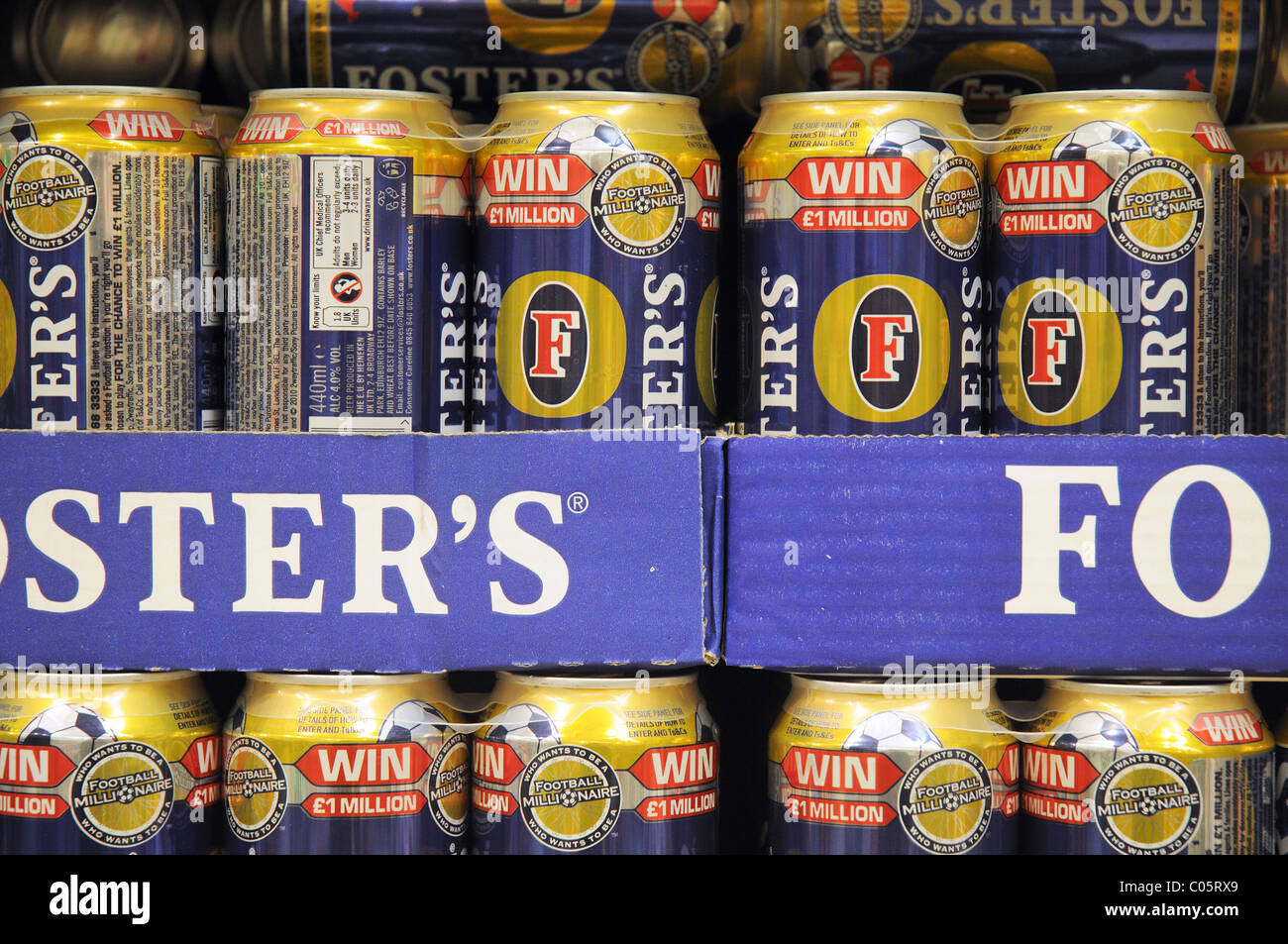Fosters lager on a shelf in a supermarket in England - Stock Image