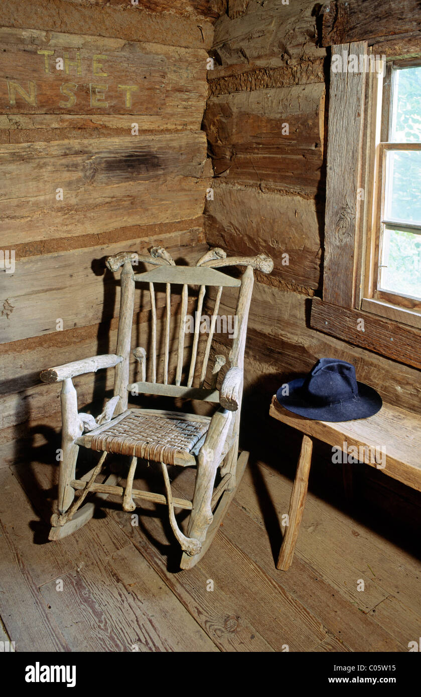The Museum of Appalachia at Norris, Tennessee, USA. A rocking chair sits in the corner of the log church - Stock Image