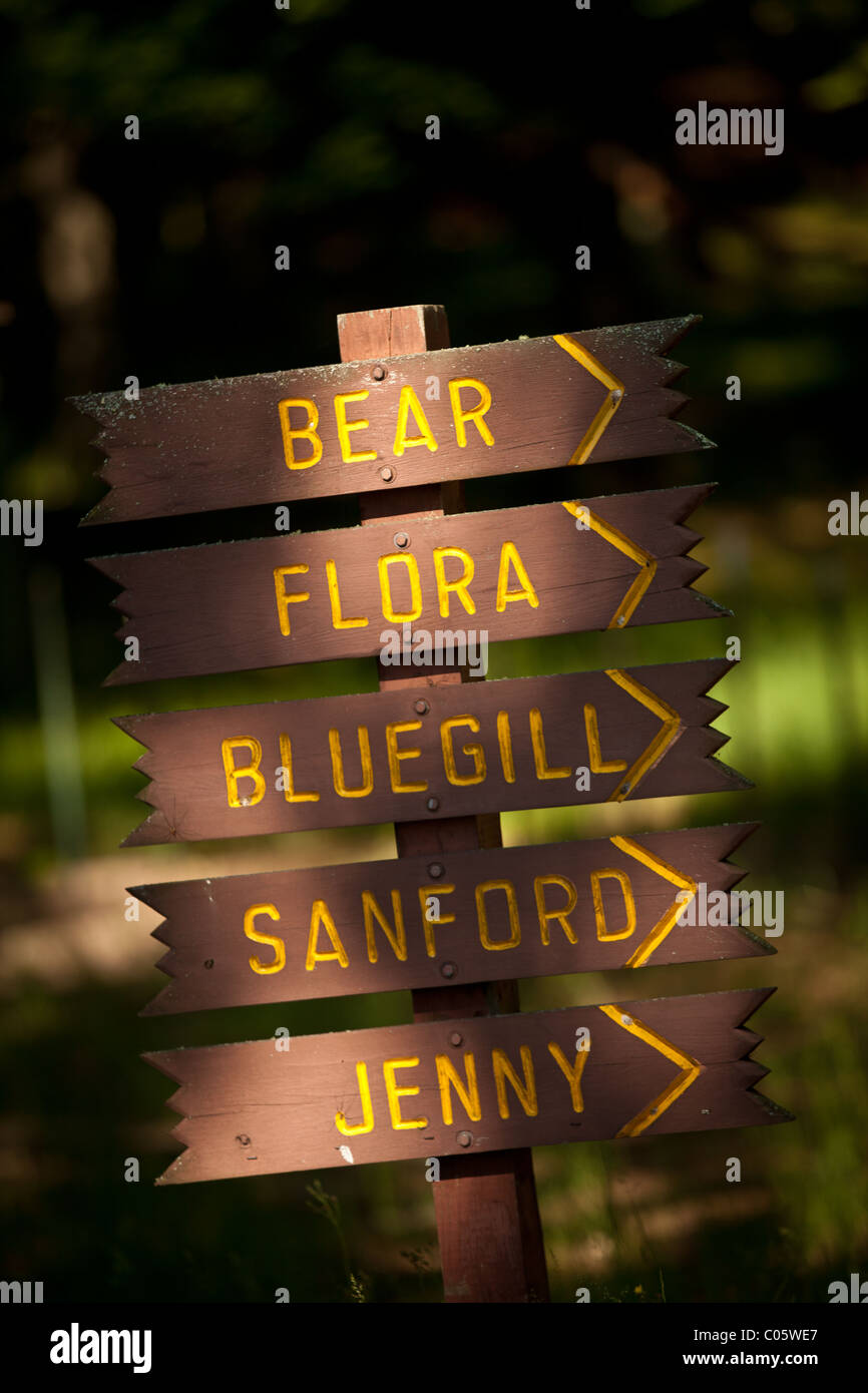 Directional signs in the Northwoods of Wisconsin. - Stock Image