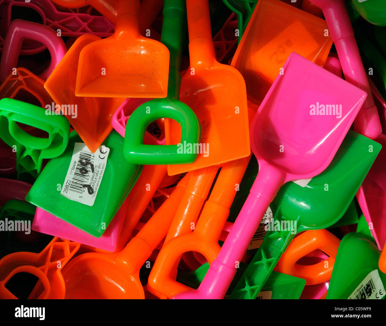 Plastic spades for the beach - Stock Image