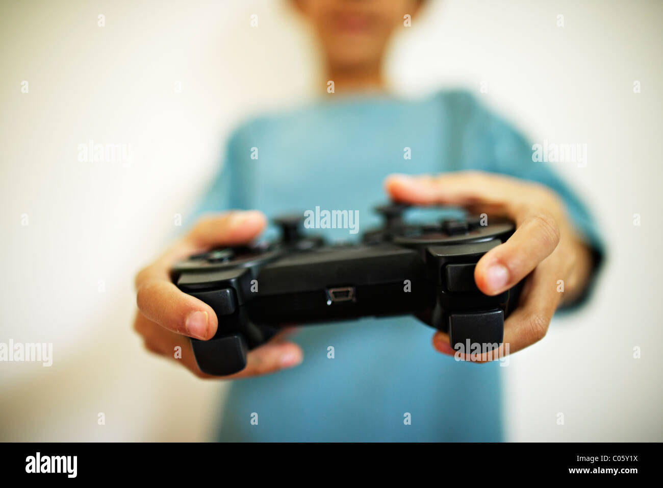 Boy plays computer games - Stock Image