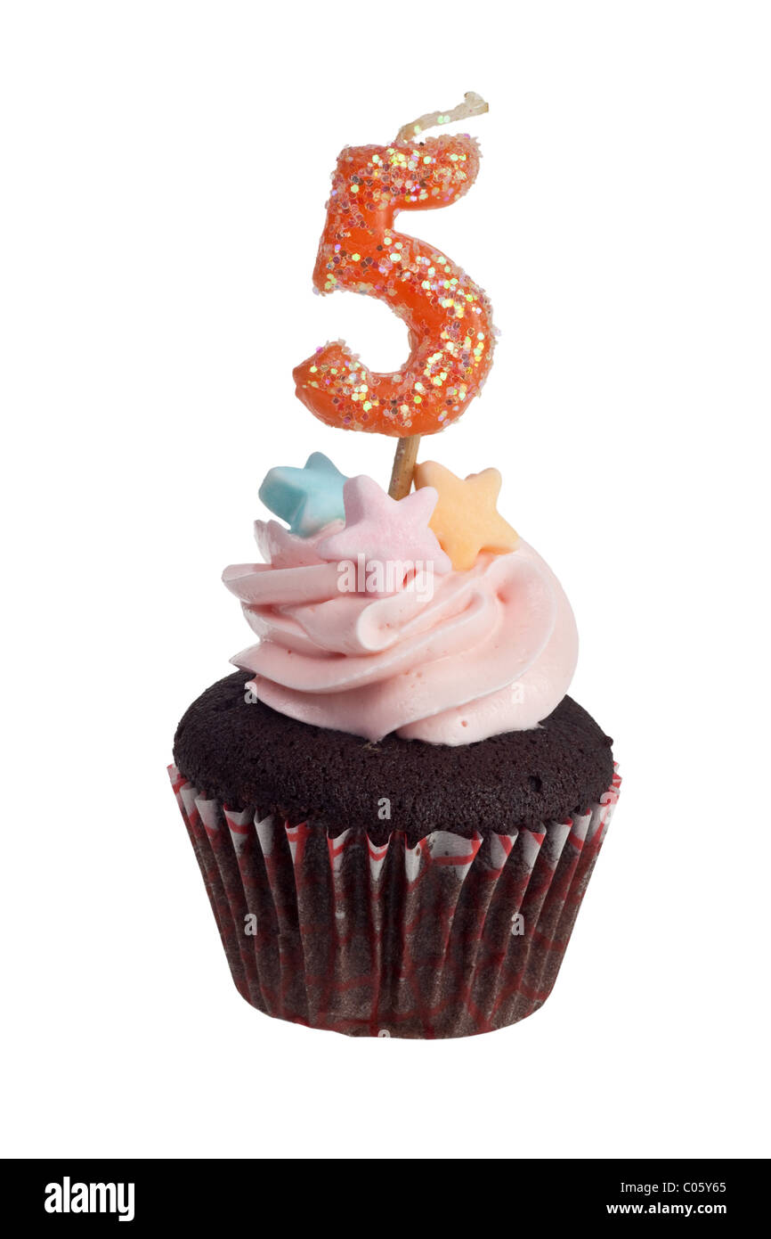 Mini cupcake with birthday candle for five year old isolated on white background Stock Photo
