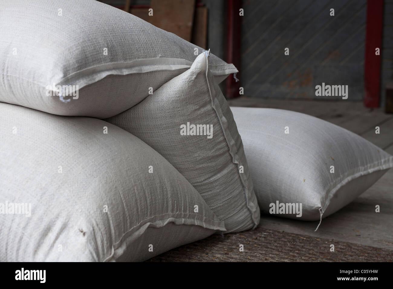 Grain Sacks. A pile of 4 grain sacks ready for milling. Flour Mill, London, Ontario, Canada - Stock Image