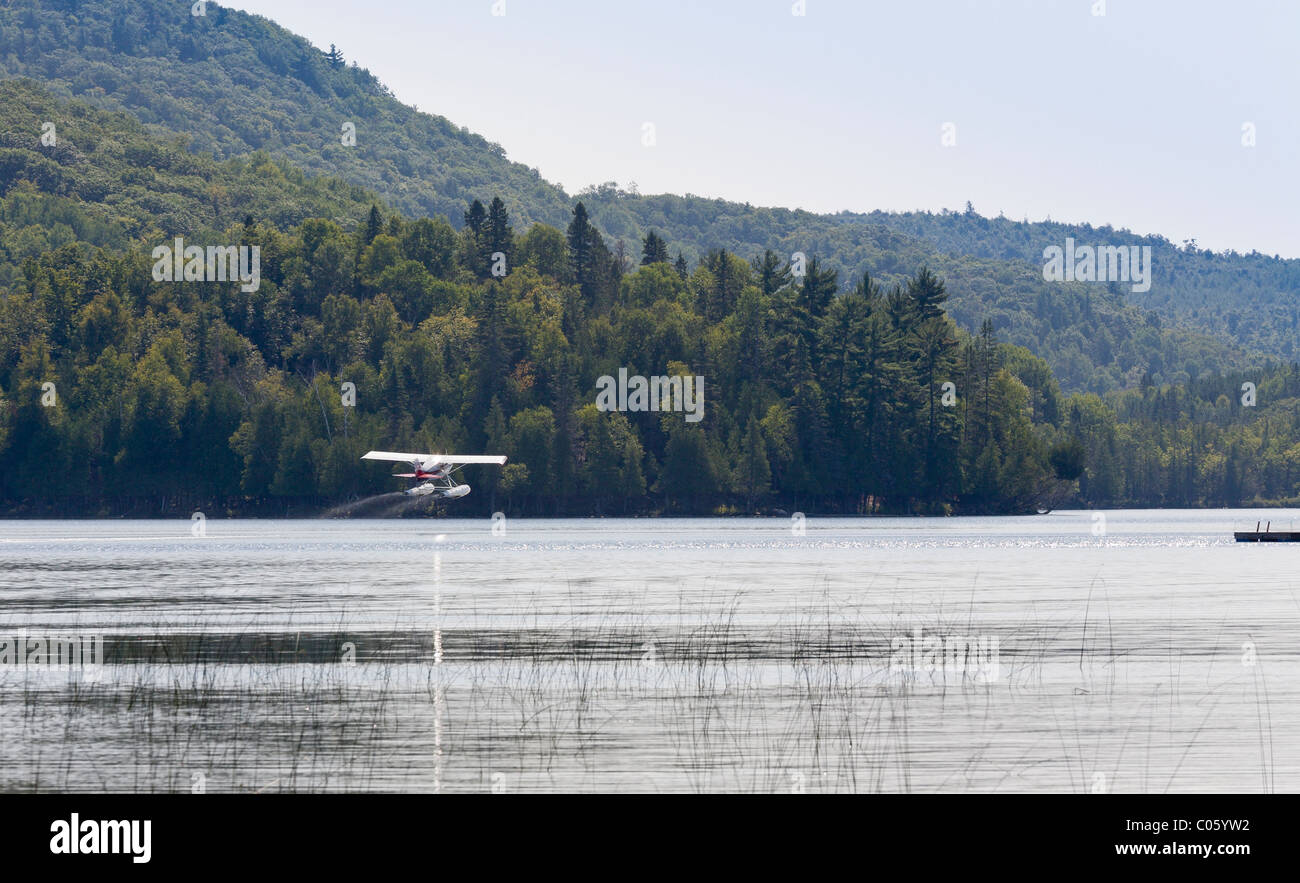 Takeoff: A small single engine float plane gets airborne. A 1974 Maule M-5-220C Lunar Rocket outfitted as a float - Stock Image