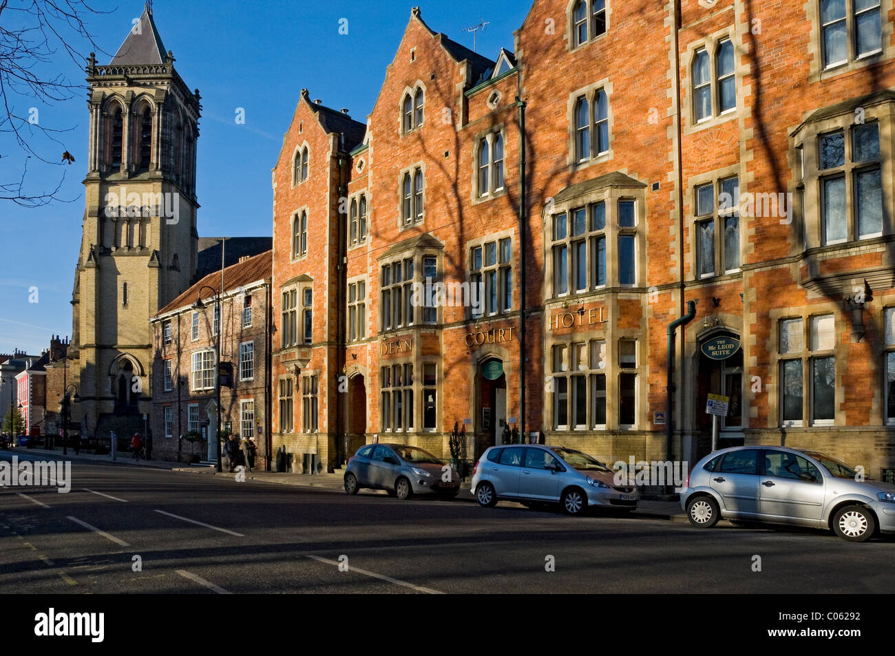 Dean Court Hotel and St Wilfrid's Church Duncombe Place York North Yorkshire England UK United Kingdom GB Great - Stock Image