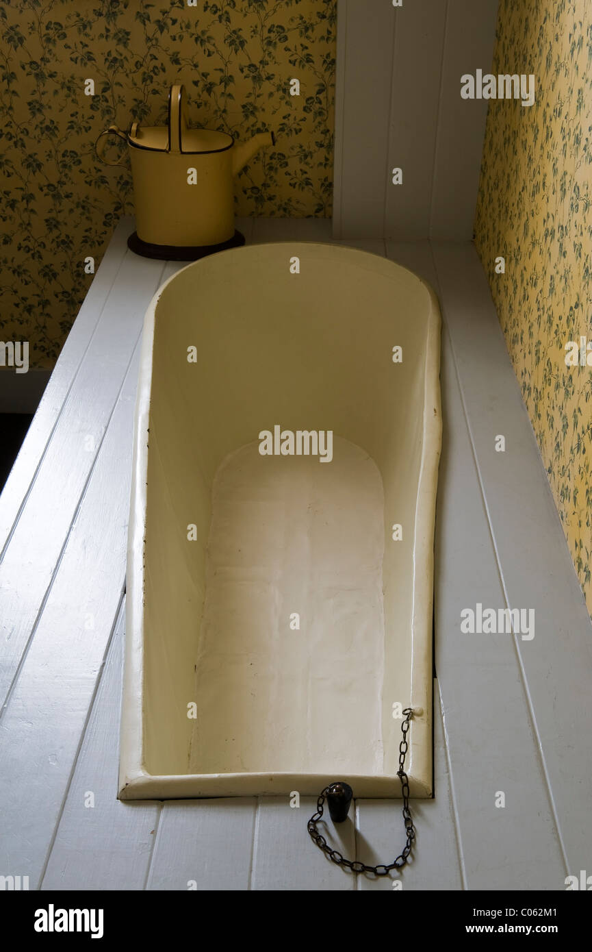 The Judge's Lodging, Presteigne, Powys, UK. A museum of Victorian life. The original bath, with a can for filling - Stock Image