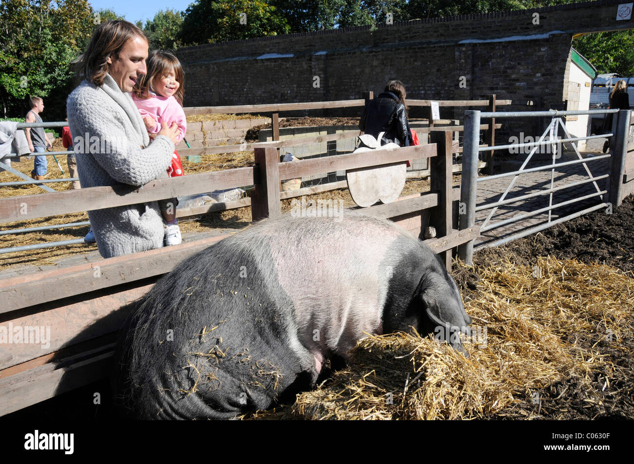 UK.Families visiting the Spitalfields City Farm in east London - Stock Image