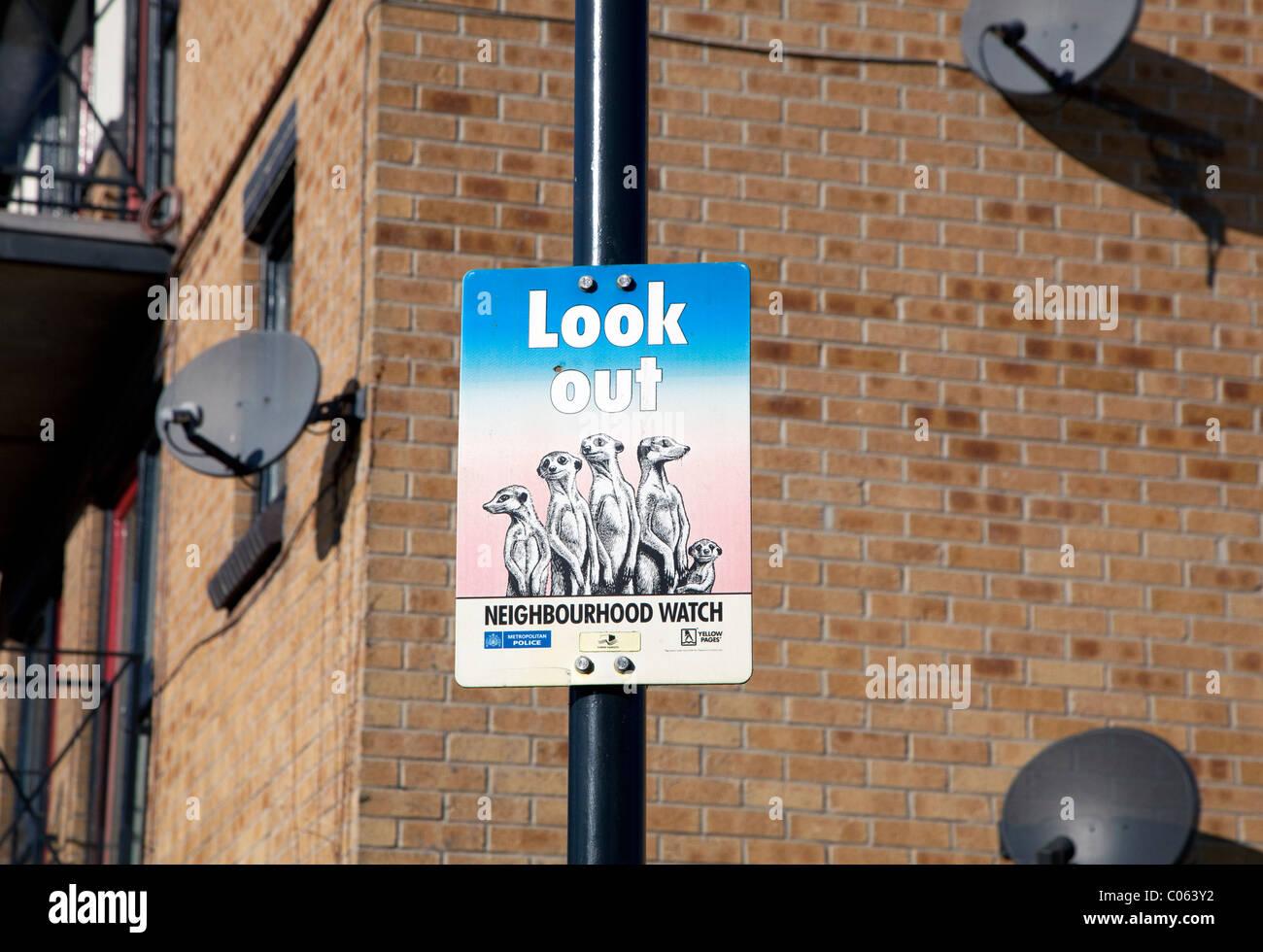 Neighbourhood Watch sign & Sky dishes, Mudchute, Isle of Dogs, London - Stock Image