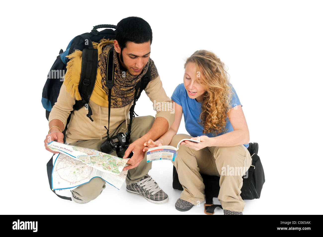 young backpacker couple lost consult map and guidebook On white Background - Stock Image