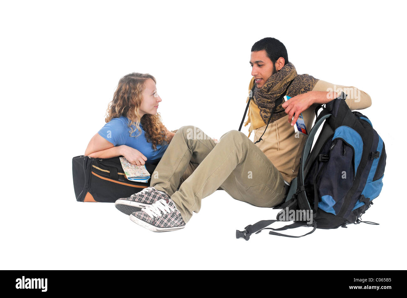 young backpacker couple at rest On white Background - Stock Image