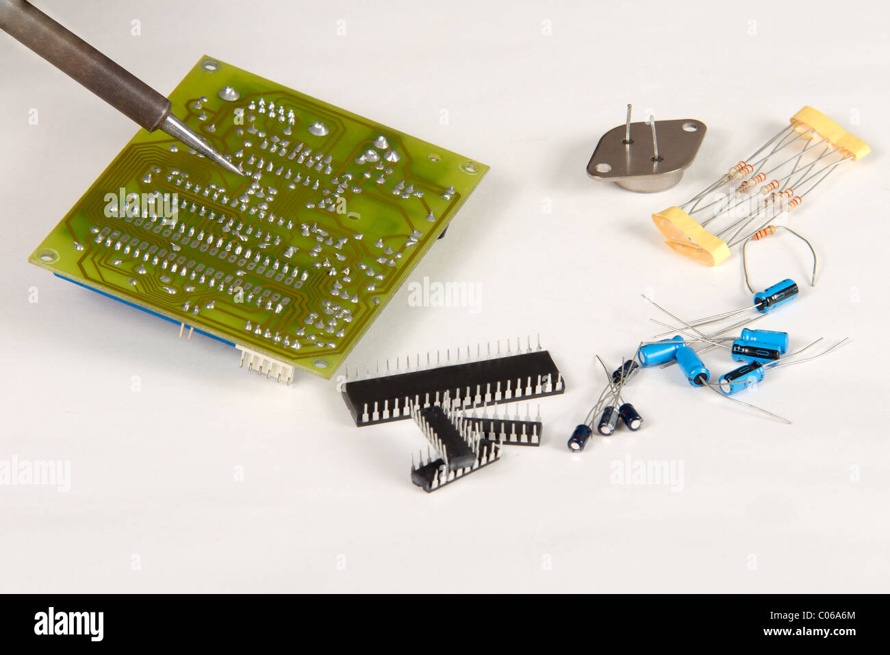 Green Tech Fix Stock Photos Images Alamy Circuit Board Engineer Soldering Surrounded By Spare Components Image