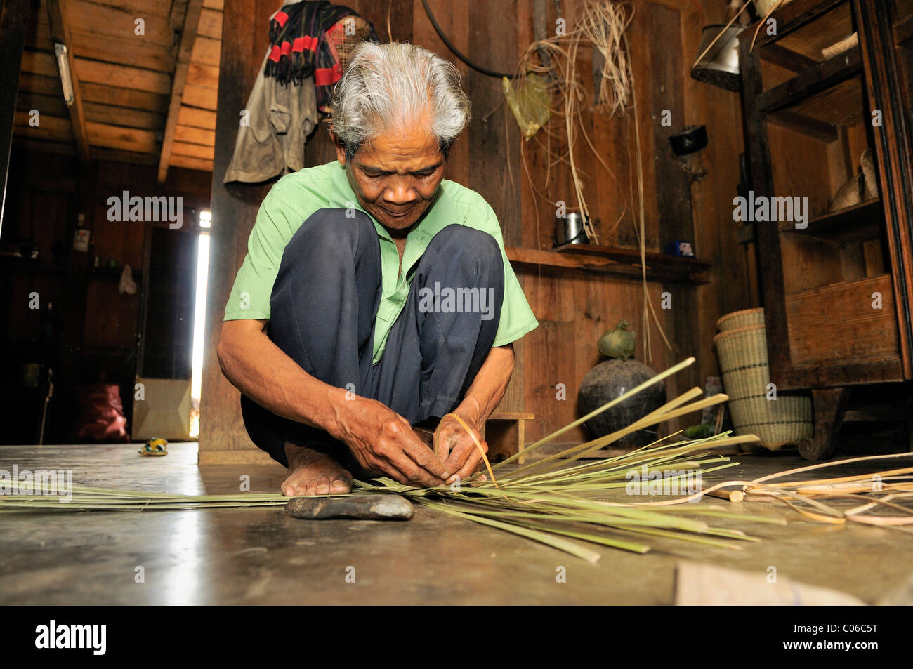 Old man weaving basket, Vietnam, Asia Stock Photo