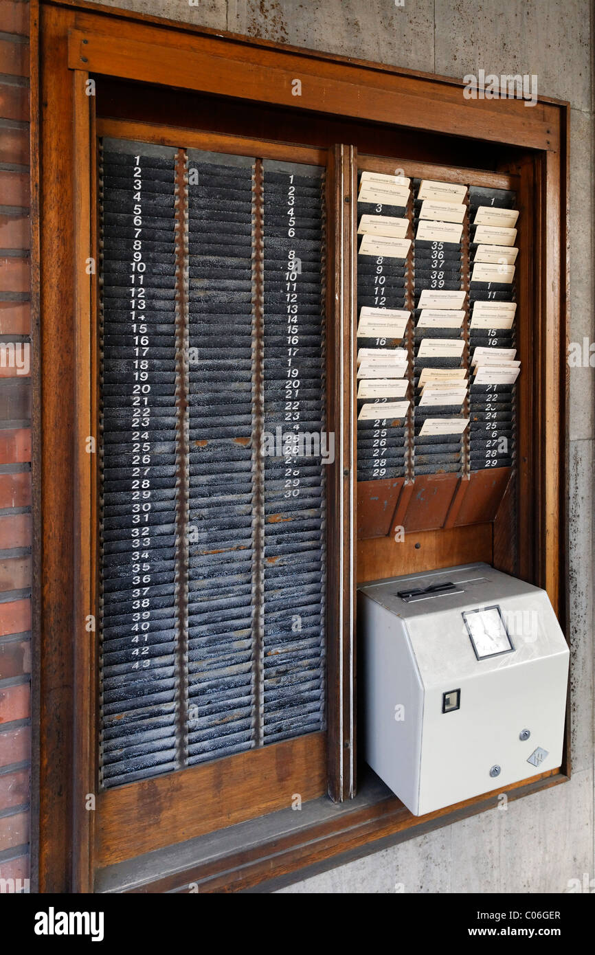 Attendance recorder or time-punch machine and time-stamped cards, former Dujardin distillery, Krefeld-Uerdingen - Stock Image
