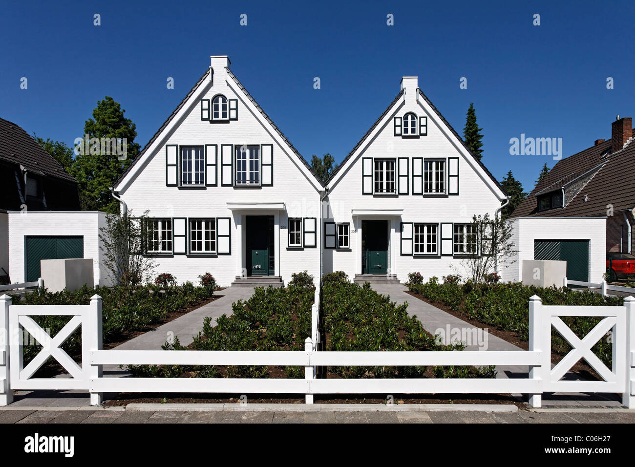 Two identical houses side by side, ready for moving in, Duesseldorf, North Rhine-Westphalia, Germany, Europe - Stock Image