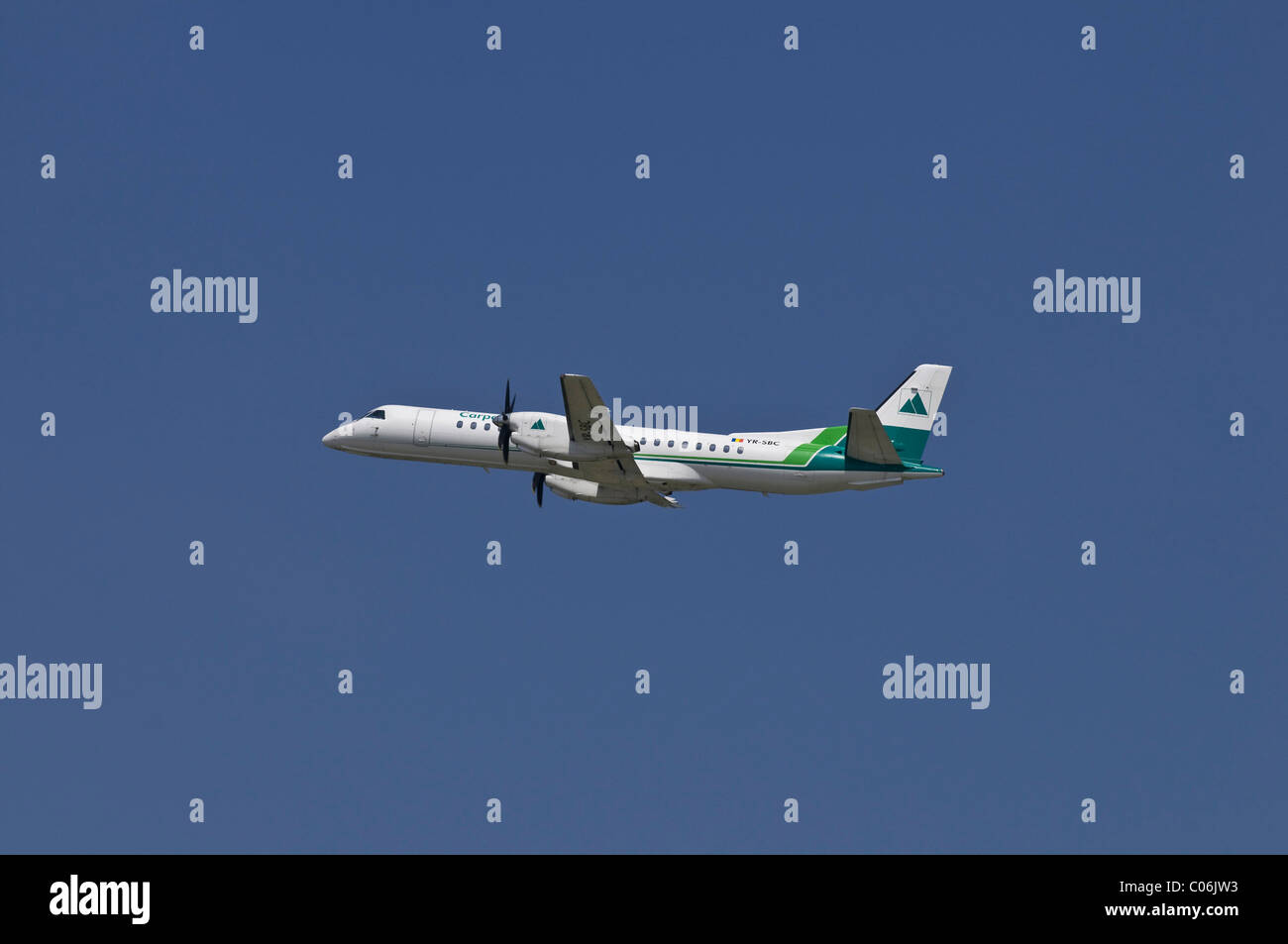 Commercial aircraft from Carpatair, a Romanian airline, climbing - Stock Image