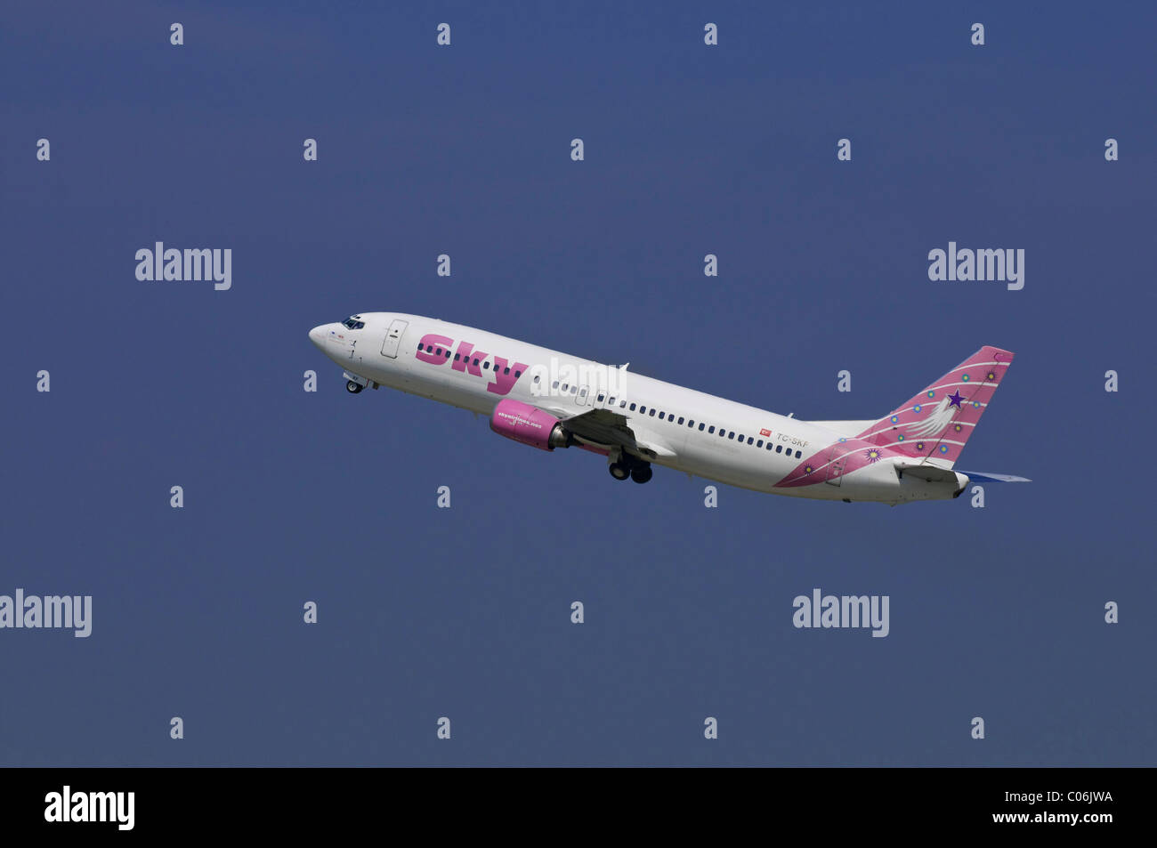Passenger aircraft from Sky Airlines, a Turkish airline, Boeing 737-400, climbing - Stock Image
