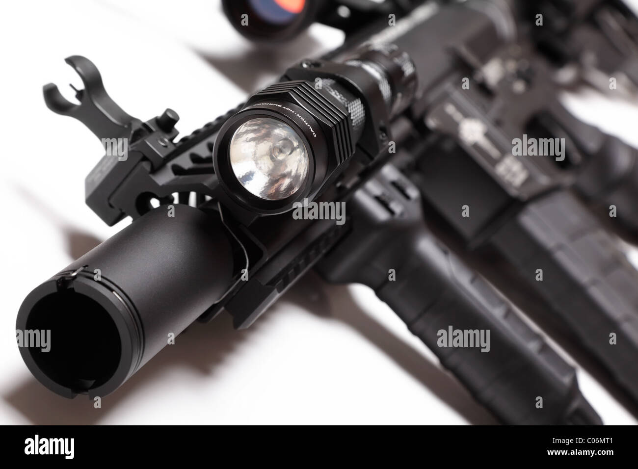 M4A1 carbine with RIS/RAS forearm and tactical flashlight. Shallow DOF. - Stock Image