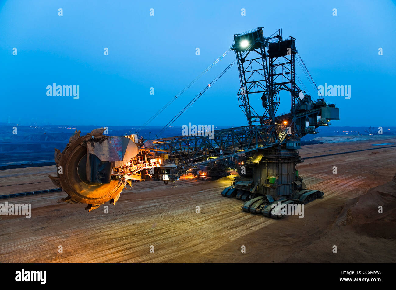 Bucket-wheel excavator changing its location in an open pit, Grevenbroich, North Rhine-Westphalia, Germany, Europe - Stock Image