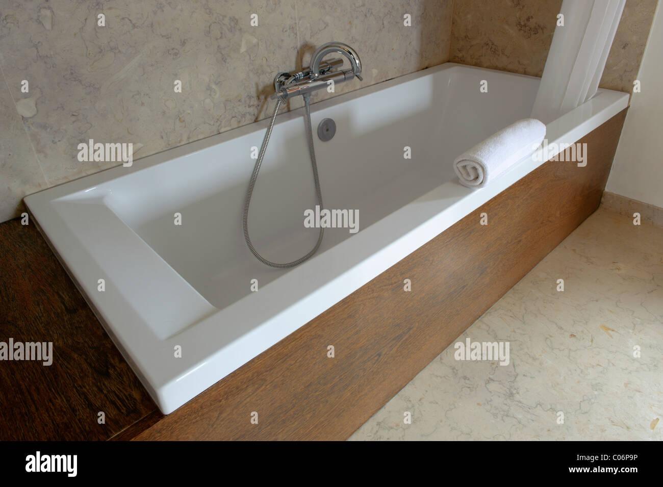 Modern contemporary bath tub - Stock Image