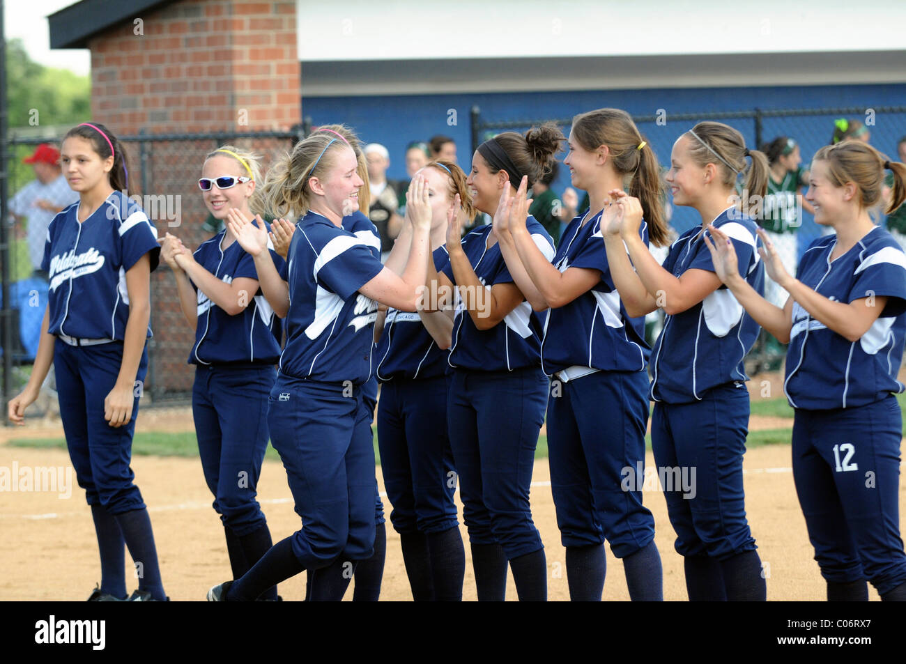 Players smile and celebrate during player introductions prior to a high school sectional playoff game. USA. - Stock Image