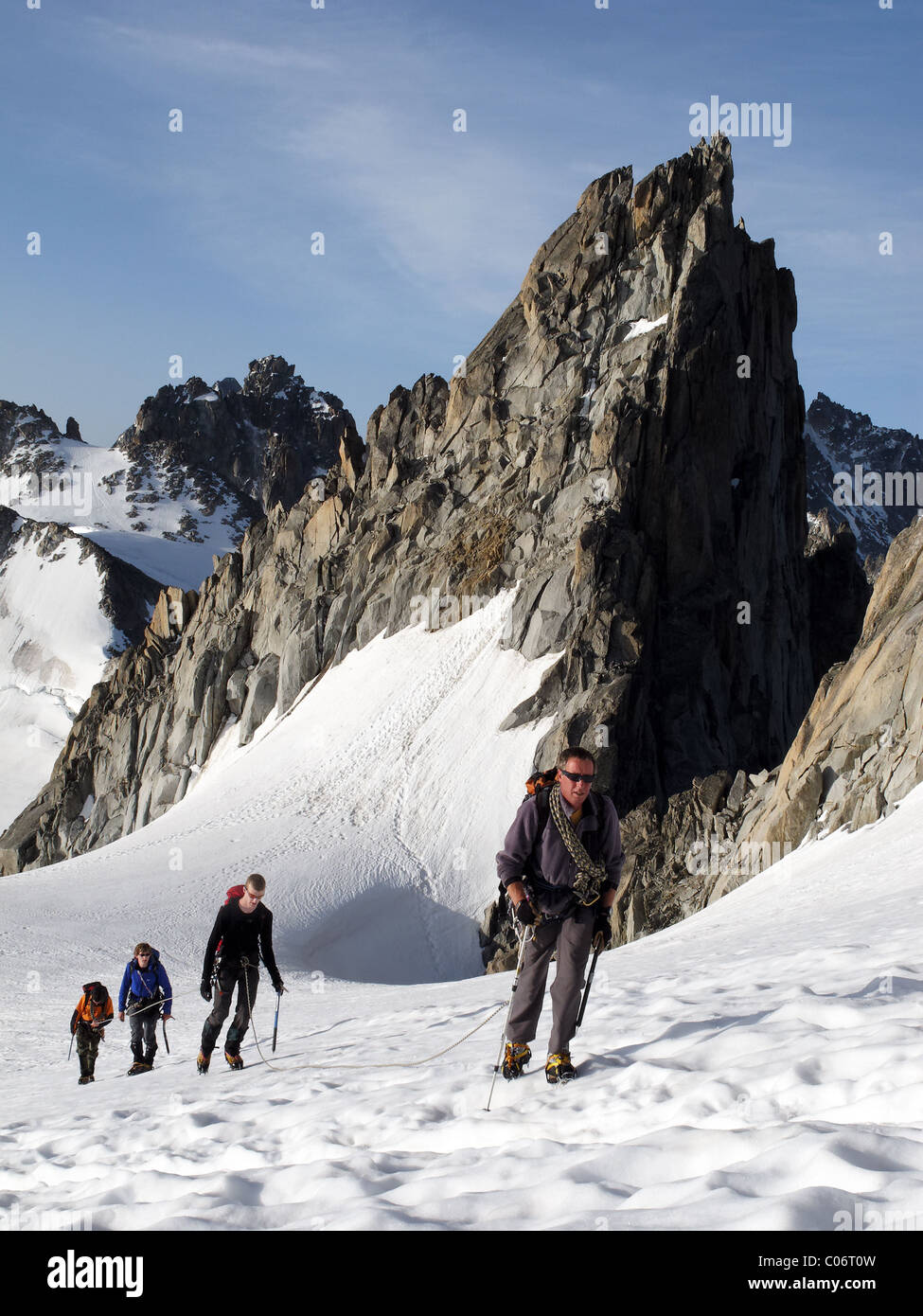 Alpine climbers on the Trient glacier approaching the Aiguille du Tour - Stock Image