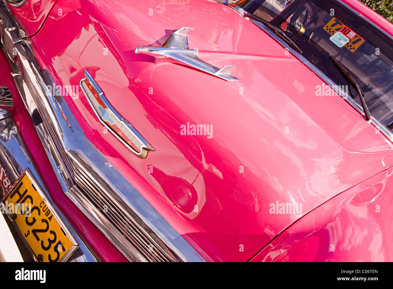 Newly restored bright pink Buick vintage American automobile used as a taxi in Havana Cuba Stock Photo