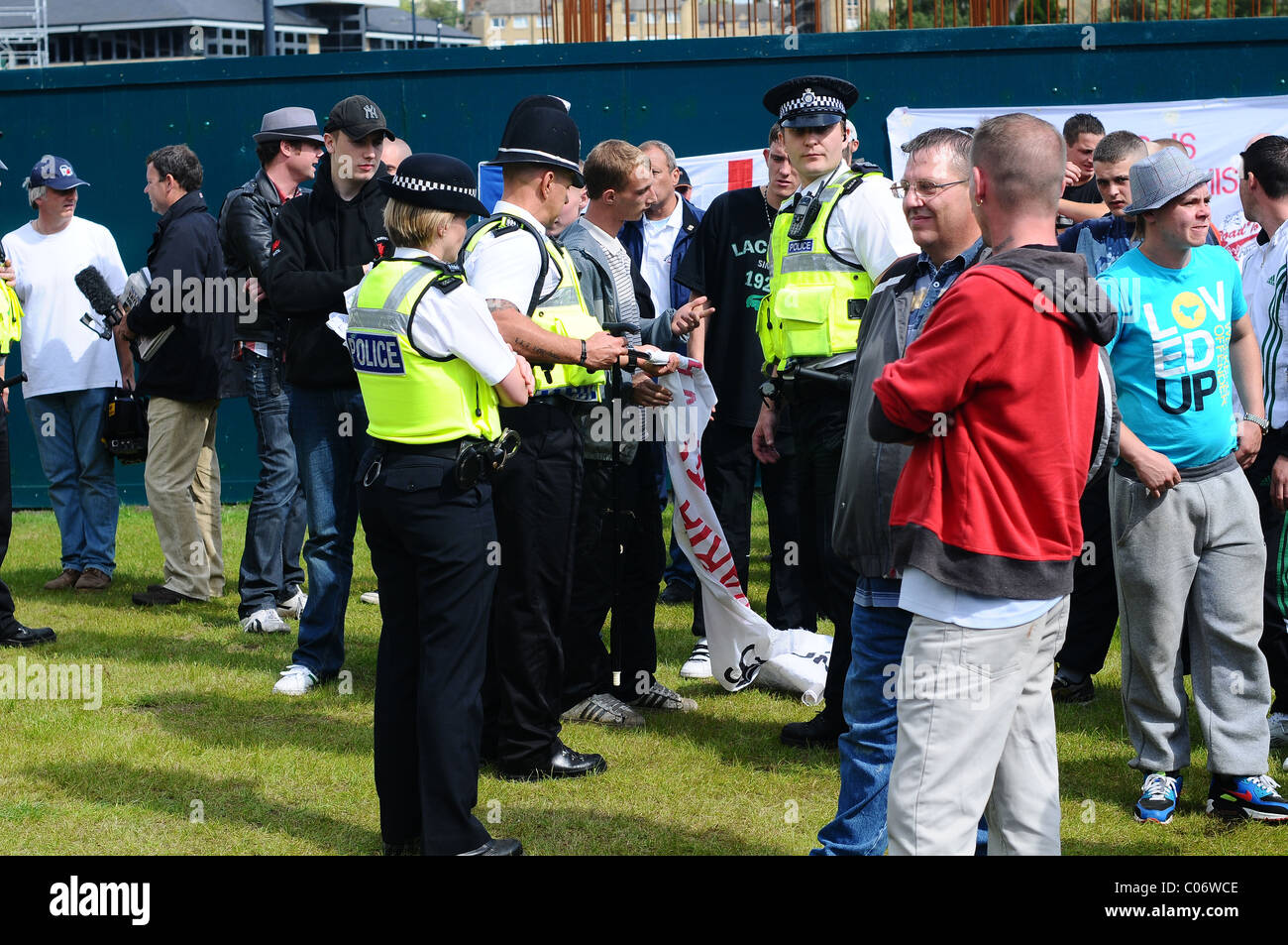 EDL supporters being searched by the police - Stock Image