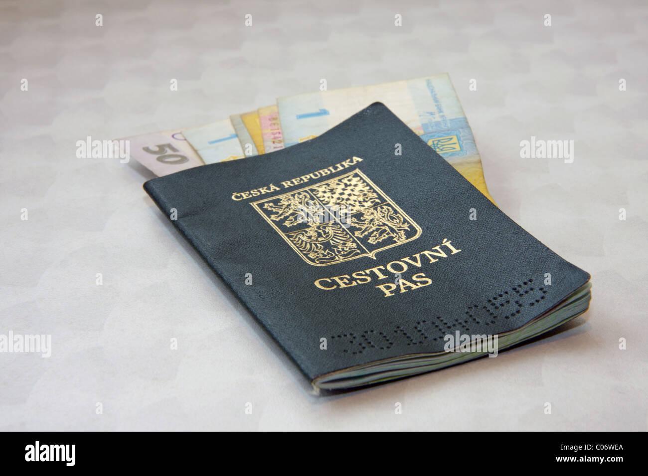 Czech passport with Ukrainian banknotes - Stock Image