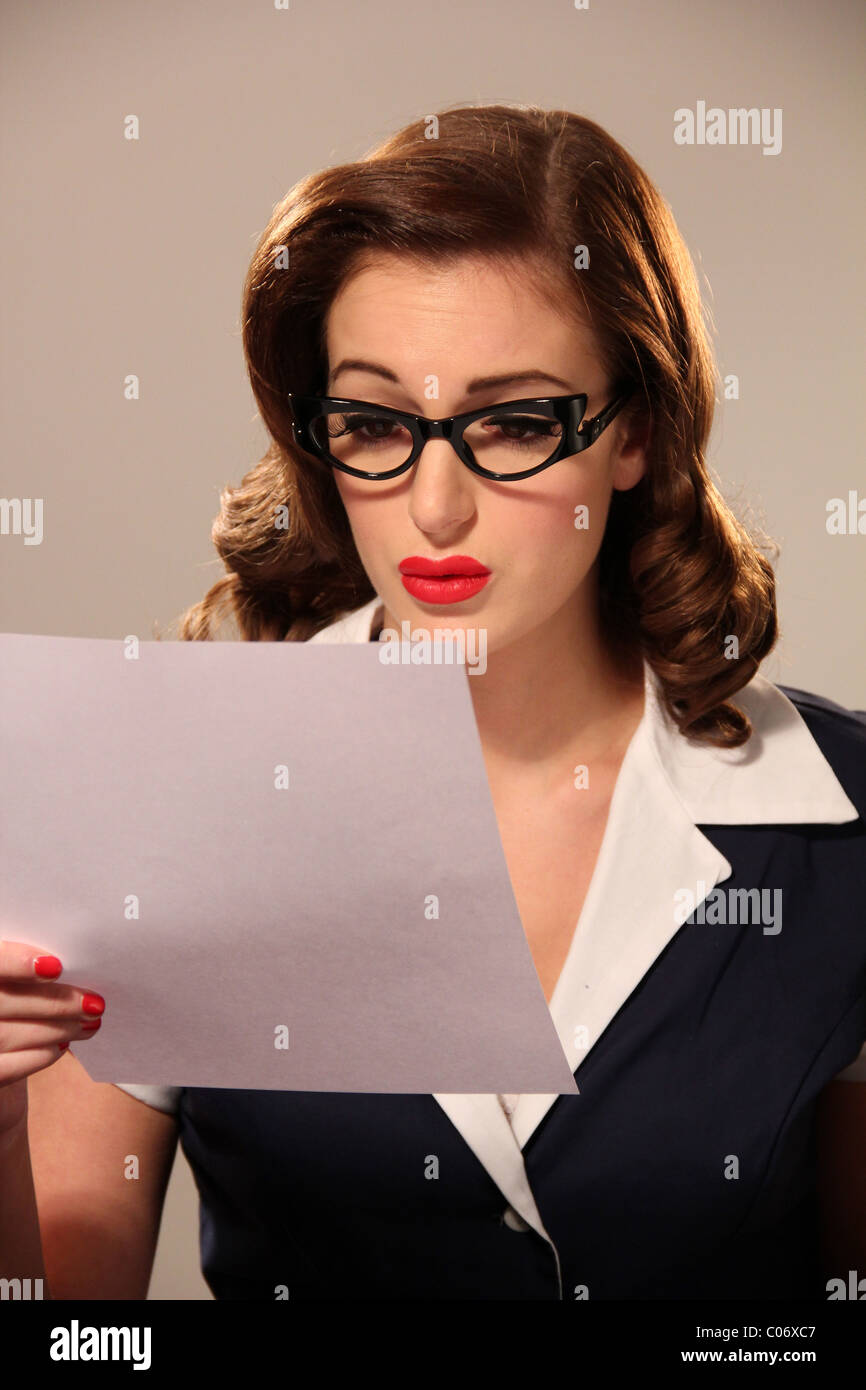 Woman in vintage clothing reading a letter - Stock Image