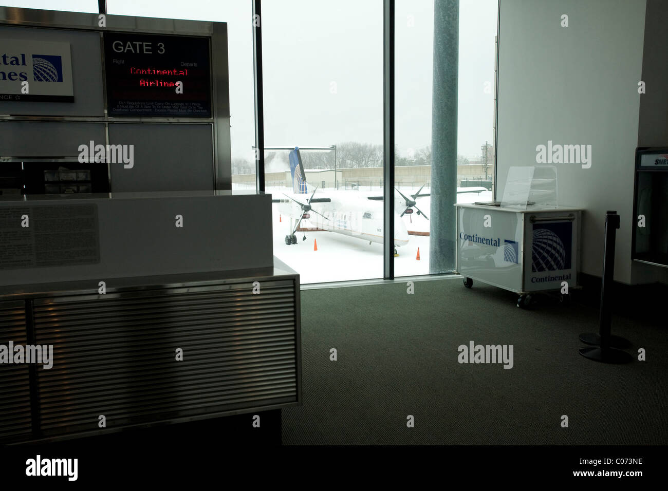 Continental Airlines gate remains empty during the shutdown of Bradley Airport during a major snowstorm. - Stock Image