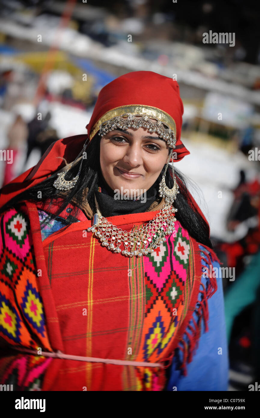 Indian Woman Dressed up for Snow - Stock Image