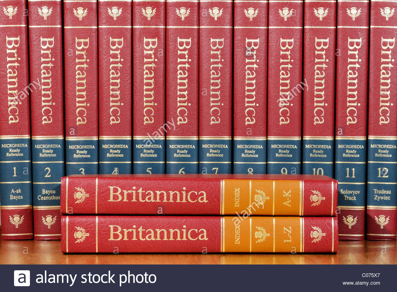 Encyclopedia Britannica Index books on a shelf with the reference books in the background, England - Stock Image