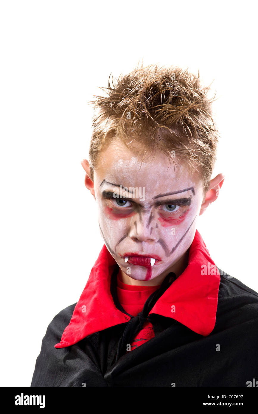 Boy, 7 years old, dressed up and made-up as a vampire - Stock Image