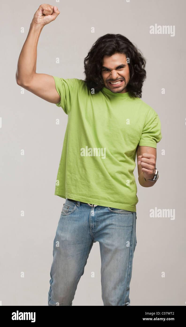 Close-up of a man cheering - Stock Image