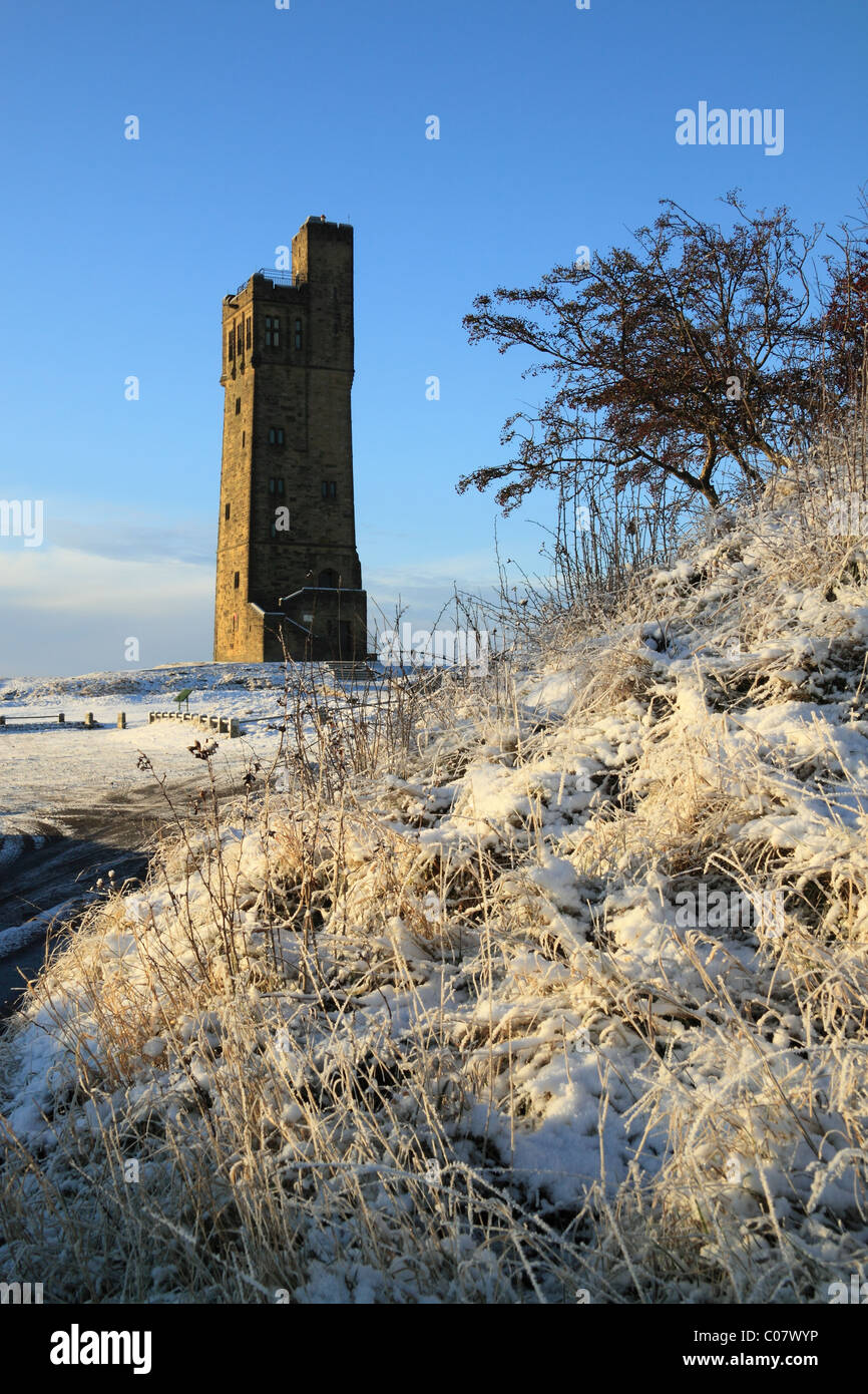 A snow covered wintertime view of the Jubilee Tower on Castle Hill, the well known landmark in Huddersfield, West - Stock Image