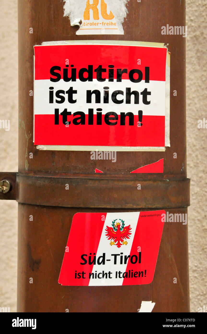 Right-wing political sticker, Suedtirol ist nicht Italien, German for South Tyrol is not Italian, on a lamppost - Stock Image