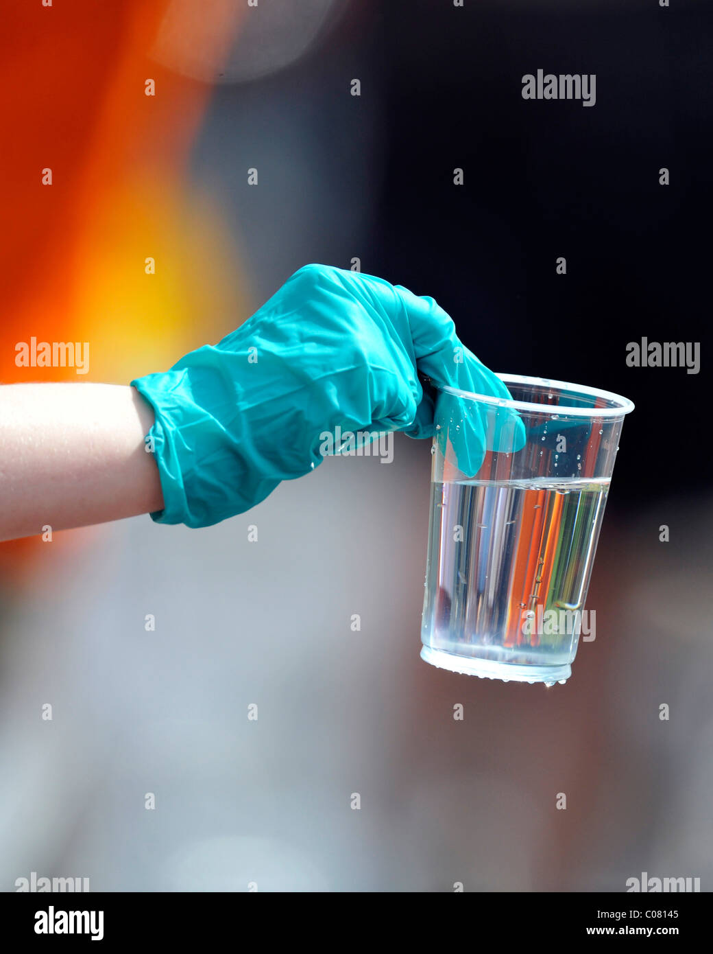 Helper handing over a cup of water, refreshment stand, Stuttgart Half Marathon, Baden-Wuerttemberg, Germany, Europe - Stock Image