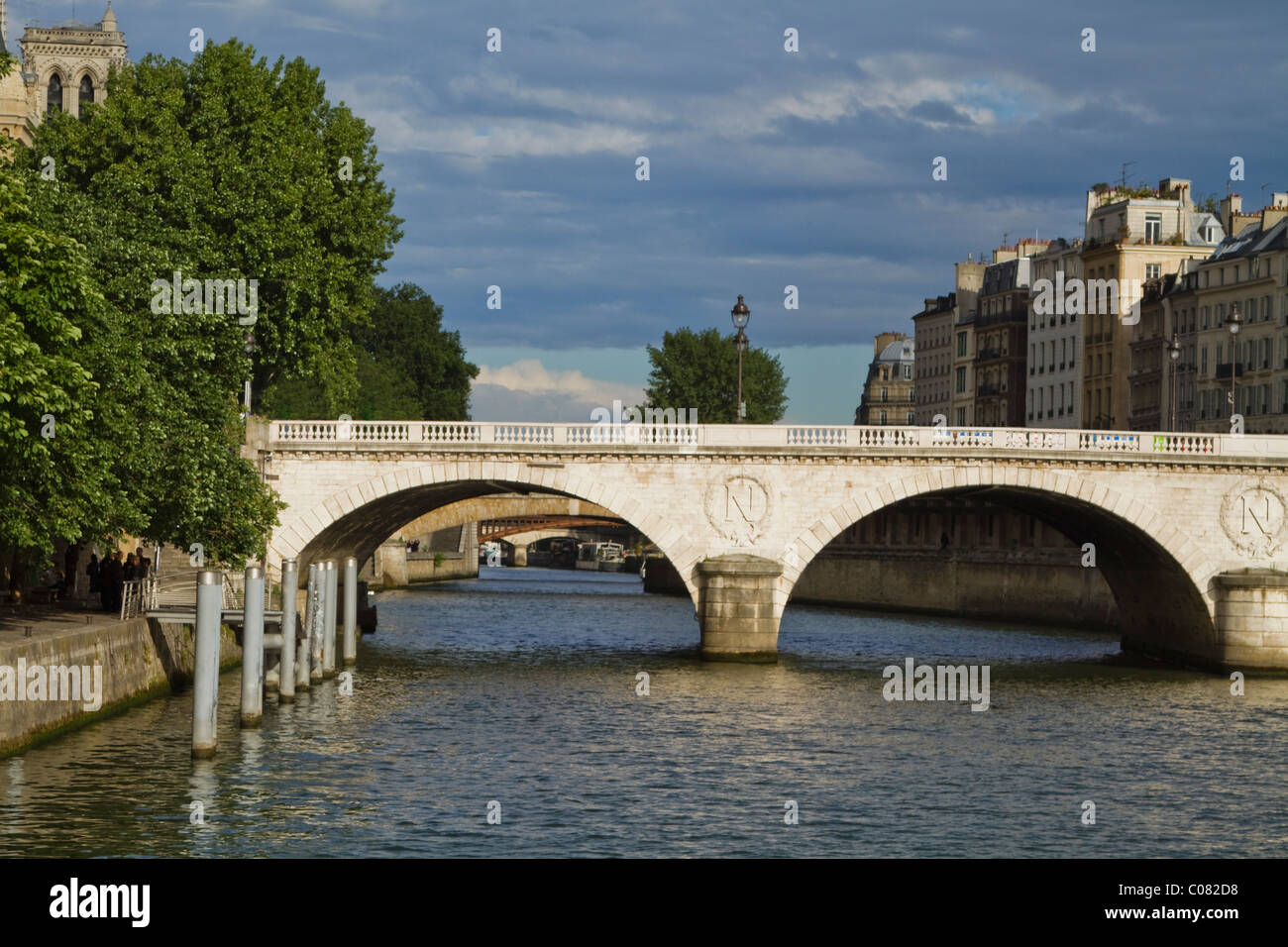 Arch bridge across the river, Pont Au Change, Seine River, Paris, France - Stock Image