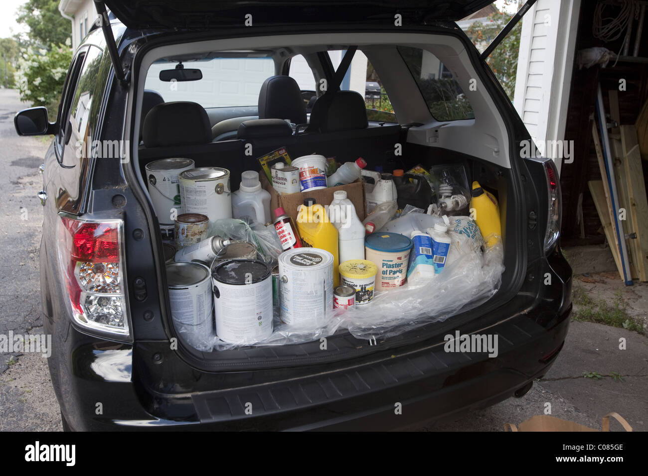 Containers of toxic and hazardous household chemicals being taken to a designated recycler - Stock Image