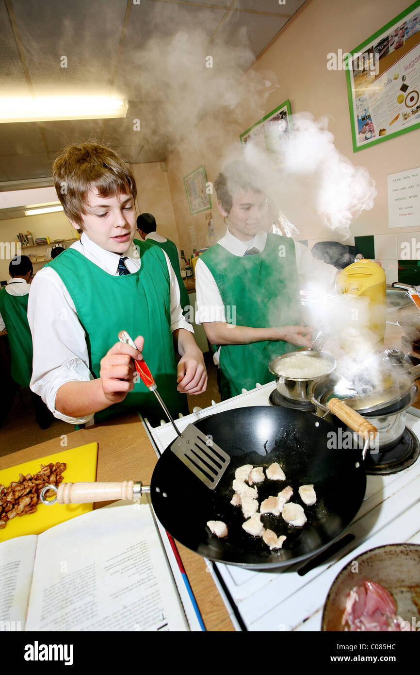 Schoolboys taking compulsory cooking lessons at  Burford School, Oxfordshire, UK. Photo:Jeff Gilbert - Stock Image