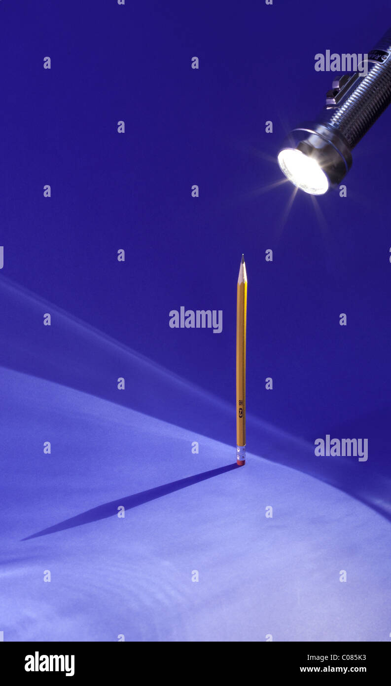 Shadow of a #2 pencil on a blue background - Stock Image